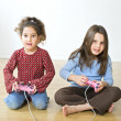 Stock Photo: Two girls playstation