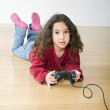 Young girl playstation - Stock Photo