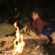 Royalty-Free Stock Photo: Boy at campfire