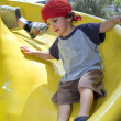 Boy on a playground slide — Stock Photo