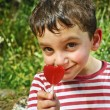 Boy with a lollypop — Stock Photo