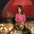 Girl at campfire - Stock Photo