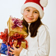Girl with christmas presents — Stockfoto