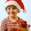 Stock Photo: Boy and presents