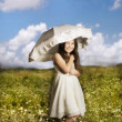 Young girl with parasol — Stock Photo #1413309