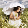 Young girl with parasol - Stock Photo