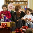 Grandparents and presents — Stock Photo