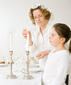 Mother and daughter sabat candels — Stock Photo