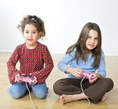 Two girls playstation — Stock Photo