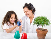 Teacher pupil sience tree — Stock Photo