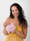 Hispanic woman and piggybank — Stock Photo