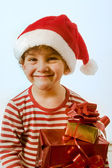 Boy and presents — Stock Photo
