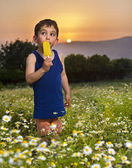 Young boy having an popsicle — Stock Photo