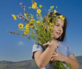 Young girl holding flowers — Stock Photo