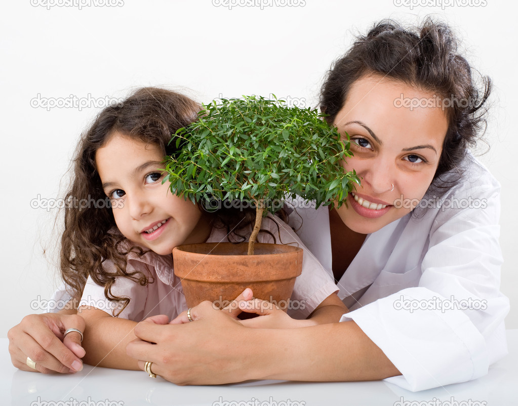 Teacher pupil  and small poted tree   Stock Photo #1411331