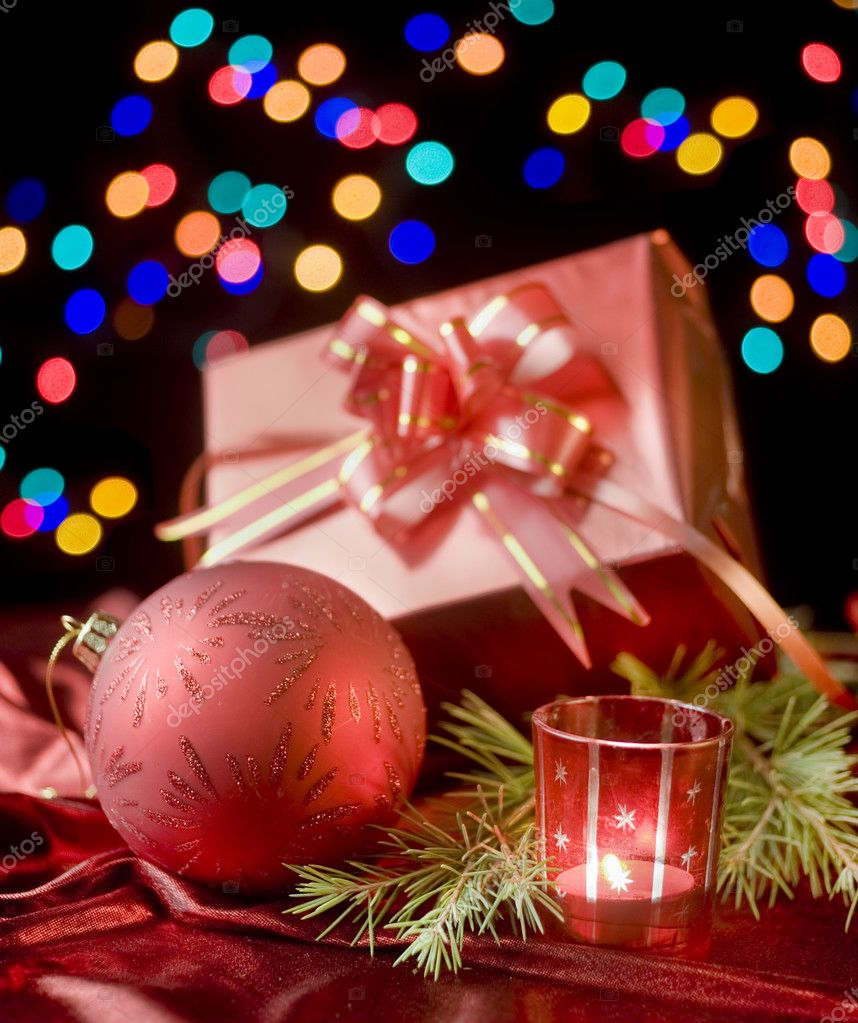 Christmas still life with presents, balls decoration and out of focus lights — Stock Photo #1412963
