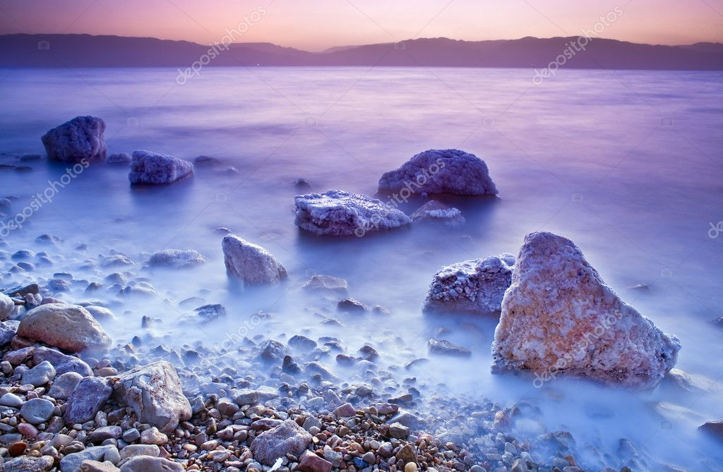 Sunrise over the dead sea with waves in motion blur — Stock Photo #1413271