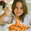 Child having spaghetti — Stock Photo