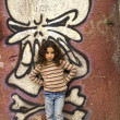 Young girl grafitti wall - Stock Photo