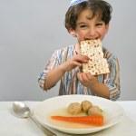 Boy matzo ball soup — Stock Photo