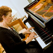 Senior women pianist — Stock Photo
