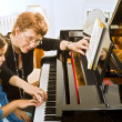 The piano teacher — Stock Photo