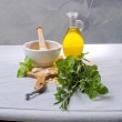Pestle mortar fresh herbs - Stock Photo