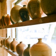 Pottery vases on shelf - Stock Photo