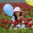 Stock Photo: Girl baloon red flowers