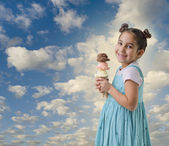 Little girl a cone with three ice cream flavors — Stock Photo