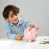 Boy piggy bank — Stock Photo