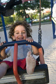 Boy on swing — Stock Photo