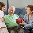 Grandparents gift grandchild — Stock Photo #2222588