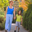 Stock Photo: Senior women walking with grandchild