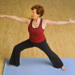 Senior woman exercising yoga — Stock Photo