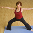 Senior woman exercising yoga — Stock Photo #2224346