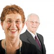 Senior businesswoman and with colleague in the b — Stock Photo