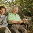 Seniors on a bench — Stock Photo
