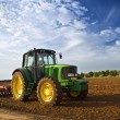 Stock Photo: Tractor in a field