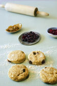 Unbaked scone and cranberries — Stock Photo