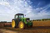 Tractor in a field — Stock Photo