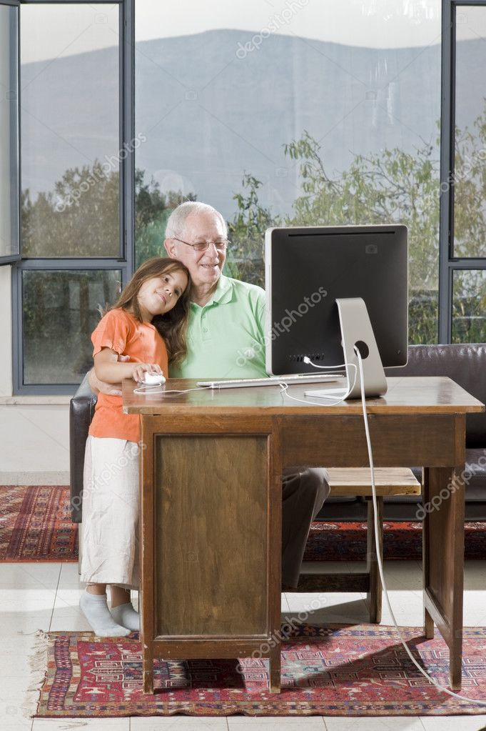 Grandfather and granddaughter with computer at home  Stock Photo #2224620