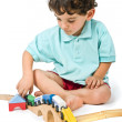 Boy playing with train - Stock Photo