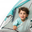 Young boy in a tent — Stock Photo