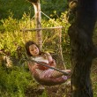 Stock Photo: Girl in hammock dream