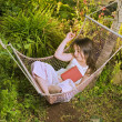 Stock Photo: Girl sleeping in hammock