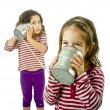 Two girls talking on a tin phone — Stock Photo #2236854