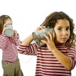 Stock Photo: Two girls talking on tin phone