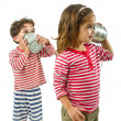 Two kids talking on a tin phone — Stock Photo #2236941