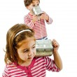 Stock Photo: Two kids talking on a tin phone